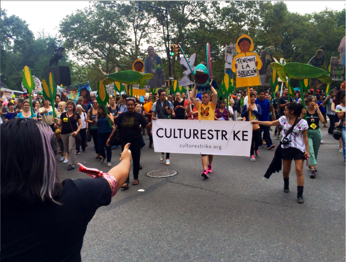 Sonia Guinansaca directs her group, Culture Strike, at last month's climate march. (Photo Credit: Tyler Daniels)